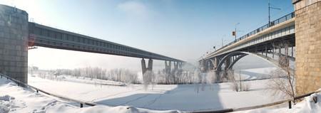 Two bridges through the river vanish in fog Stock Photo