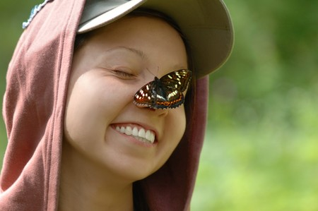 Portrait of a happy girl with a butterfly Stock Photo