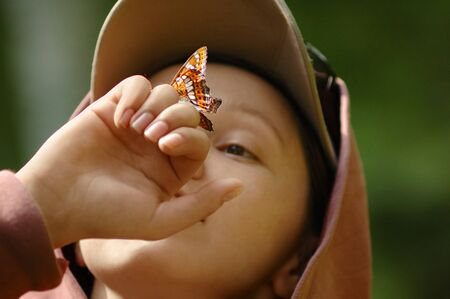 Picture of a happy girl with a butterfly on her hand