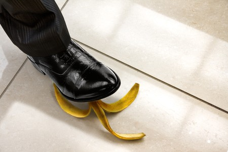 men shoe stepping on banana peel, top view