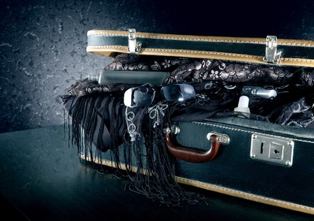 A suitcase packed with party dresses