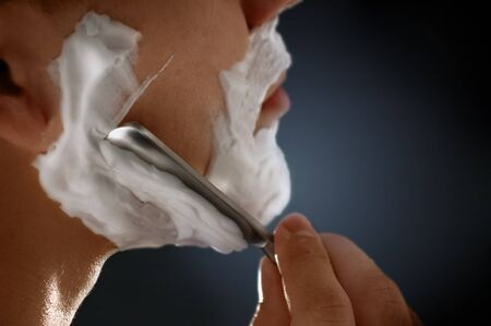 Close-up of a man shaving