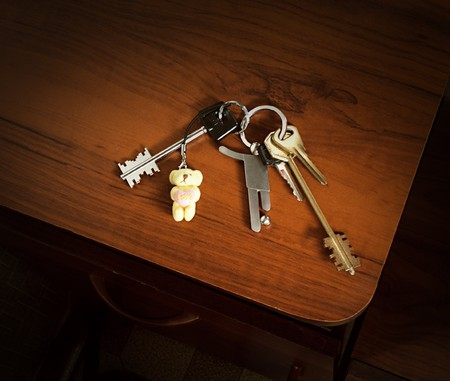 trinkets: A bunch of keys with a soccer player and a teddy bear trinkets Stock Photo