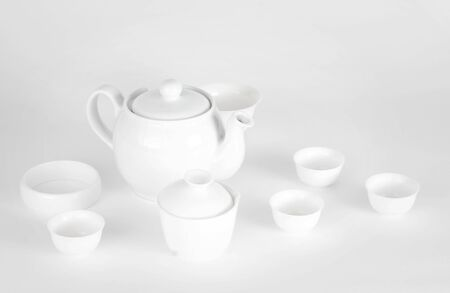 A picture of plain white china teapot and cups photo