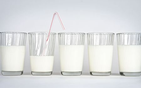 Five glasses on a white background with milk Stock Photo