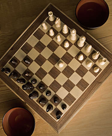 battling: chessboard with chess piece on start position