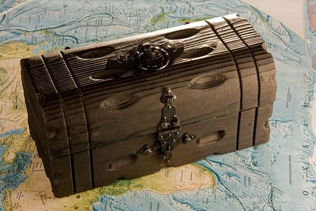 closed wooden chest on the map Stock Photo