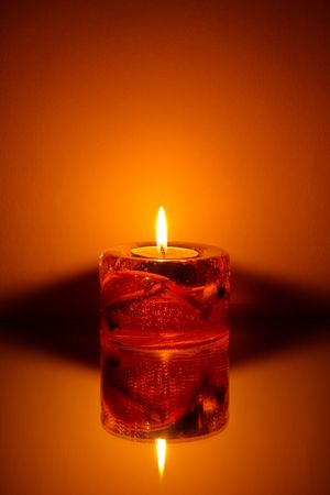 Singl candle on orange background Stock Photo