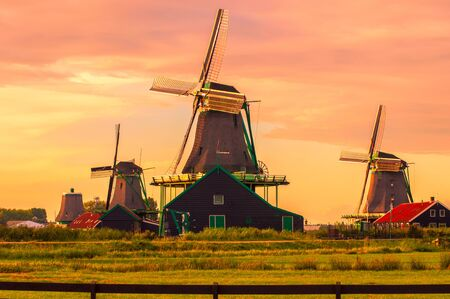 Fantastic view on windmills in Zaanse Schans near Amsterdam Stock Photo