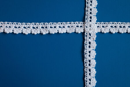 white trim: Vintage cream colored ribbons on blue background