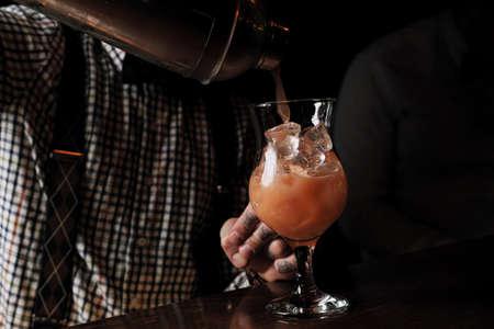 Bartender is making cocktail at bar counter Reklamní fotografie
