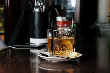 whiskey and natural ice on old wooden table Imagens - 123046394
