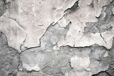 Fragment of the old wall with decaying and fallen off plaster art