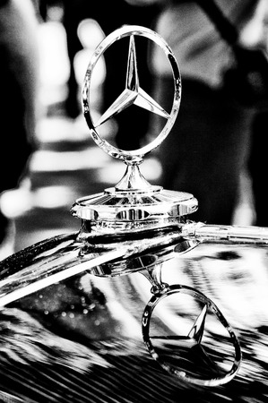 benz: Mercedes-Benz symbol on the hood  Black and White , the exhibition  125 car history - 125 years of history Kurfurstendamm , May 28, 2011 in Berlin, Germany Editorial