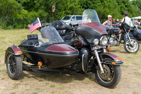 glide: The motorcycle with sidecar Harley-Davidson Electra Glide  Ultra Classic ,  The oldtimer show  in MAFZ, May 26, 2012 in Paaren im Glien, Germany