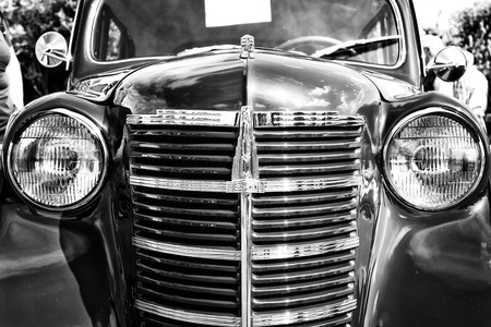 postwar: PAAREN IM GLIEN, GERMANY - MAY 19  Soviet post-war cars Moskvitch 401  based on the German Opel Kadett 1939 , black and white,   The oldtimer show  in MAFZ, May 19, 2013 in Paaren im Glien, Germany