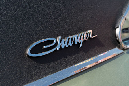 coke bottle: PAAREN IM GLIEN, GERMANY - MAY 19: The emblem of mid-size car Dodge Charger RT, (black and white), The oldtimer show in MAFZ, May 19, 2013 in Paaren im Glien, Germany