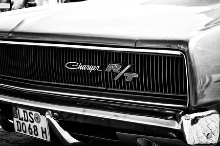 coke bottle: PAAREN IM GLIEN, GERMANY - MAY 19: Detail of the front of the mid-size car Dodge Charger RT, (black and white), The oldtimer show in MAFZ, May 19, 2013 in Paaren im Glien, Germany