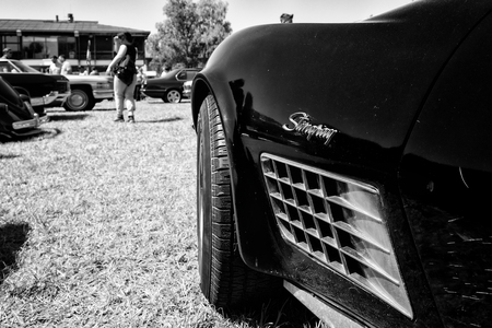 third wheel: PAAREN IM GLIEN, GERMANY - MAY 19: Detail of the sports car Chevrolet Corvette Stingray Coupe, (black and white) The oldtimer show in MAFZ, May 19, 2013 in Paaren im Glien, Germany Editorial