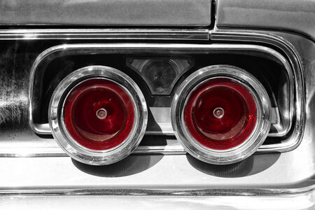 coke bottle: PAAREN IM GLIEN, GERMANY - MAY 19: The rear brake light midsize car Dodge Charger RT, (black and white), The oldtimer show in MAFZ, May 19, 2013 in Paaren im Glien, Germany