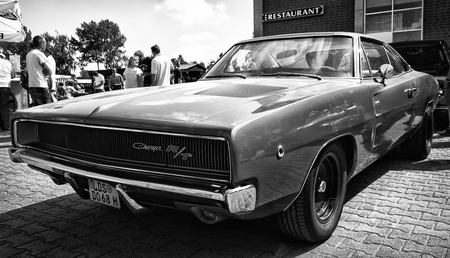coke bottle: PAAREN IM GLIEN, GERMANY - MAY 19: Mid-size car Dodge Charger RT, (black and white), The oldtimer show in MAFZ, May 19, 2013 in Paaren im Glien, Germany Editorial