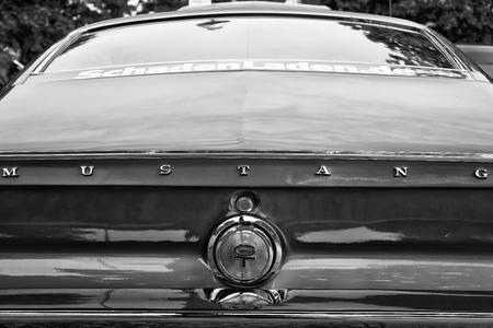 chromium plated: BERLIN - MAY 11  Rear view auto Shelby Mustang GT350, black and white, close-up, 26th Oldtimer-Tage Berlin-Brandenburg, May 11, 2013 Berlin, Germany Editorial