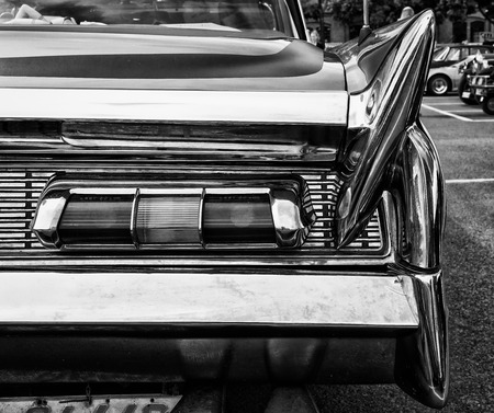 custom car: BERLIN - MAY 11: The rear brake lights Car Lincoln Premier Coupe Custom Showcar 1960 (black and white), 26th Oldtimer-Tage Berlin-Brandenburg, May 11, 2013 Berlin, Germany