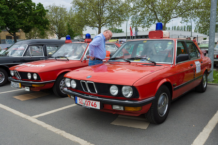 flashers: BERLIN - MAY 11: Cars rescue BMW 5 Series (E12) in the background, and the BMW 5 Series (E28) in the foreground, 26th Oldtimer-Tage Berlin-Brandenburg, May 11, 2013 Berlin, Germany