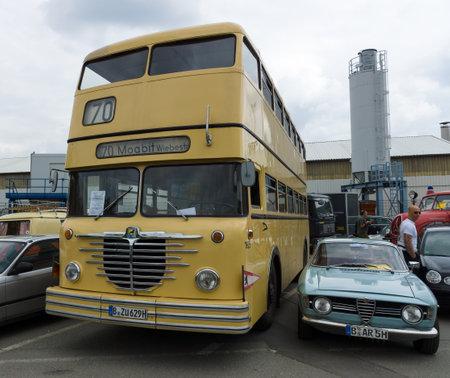 omnibus: BERLIN - MAY 11: Bus Buessing Omnibus D2U Doppeldecker and Alfa Romeo GT 1300 Junior, 26th Oldtimer-Tage Berlin-Brandenburg, May 11, 2013 Berlin, Germany