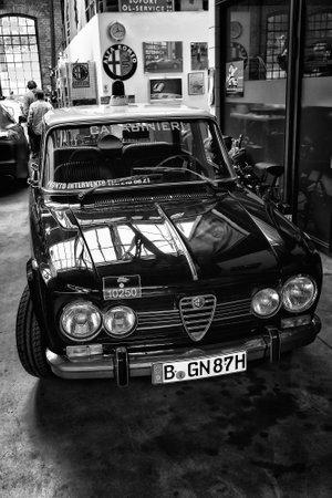 motor officer: BERLIN - MAY 11: Italian four-door sedan Alfa Romeo Giulia Nuova Super (black and white), 26th Oldtimer-Tage Berlin-Brandenburg, May 11, 2013 Berlin, Germany