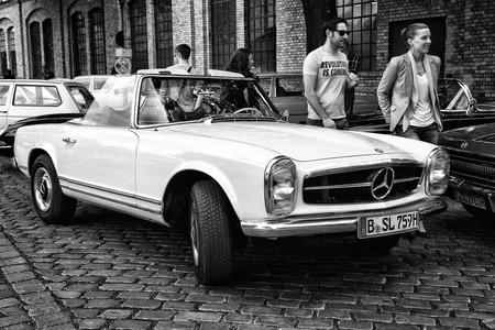 tage: BERLIN - MAY 11: A sports car, a two-door coupe Mercedes-Benz W113, 230SL Automatic (black and white), 26th Oldtimer-Tage Berlin-Brandenburg, May 11, 2013 Berlin, Germany
