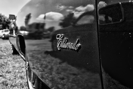 brougham: PAAREN IM GLIEN, GERMANY - MAY 19: Emblem of full-size personal luxury car Cadillac Eldorado, black and white, The oldtimer show in MAFZ, May 19, 2013 in Paaren im Glien, Germany