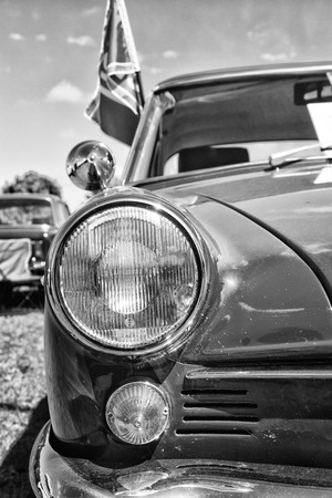 PAAREN IM GLIEN, GERMANY - MAY 19: Headlamp sports coupe NSU Sport-Prinz, black and white, The oldtimer show in MAFZ, May 19, 2013 in Paaren im Glien, Germany