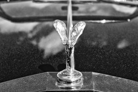 PAAREN IM GLIEN, GERMANY - MAY 19: The famous emblem Spirit of Ecstasy on a Rolls-Royce Corniche, black and white, The oldtimer show in MAFZ, May 19, 2013 in Paaren im Glien, Germany