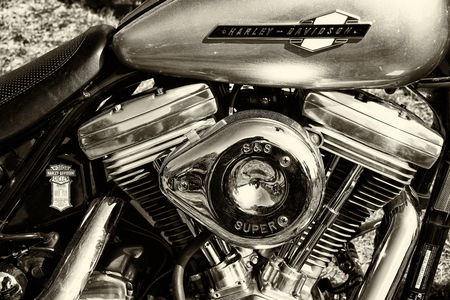 twin engine: PAAREN IM GLIEN, GERMANY - MAY 19: Detail of the motorcycle Harley-Davidson, sepia, The oldtimer show in MAFZ, May 19, 2013 in Paaren im Glien, Germany Editorial
