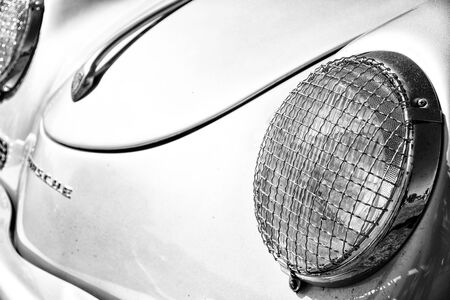 speedster: PAAREN IM GLIEN, GERMANY - MAY 19: Detail of the front of the sports car Porsche 356 Speedster, black and white, The oldtimer show in MAFZ, May 19, 2013 in Paaren im Glien, Germany Editorial