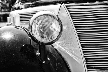 headlamp: PAAREN IM GLIEN, GERMANY - MAY 19  Headlamp car Ford Eifel,  black and white  The oldtimer show in MAFZ, May 19, 2013 in Paaren im Glien, Germany