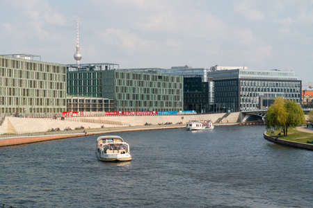 residents: BERLIN, GERMANY - APRIL 19, 2014: Pleasure boat on the river Spree. Traditional pastime visitors and residents of of Berlin.
