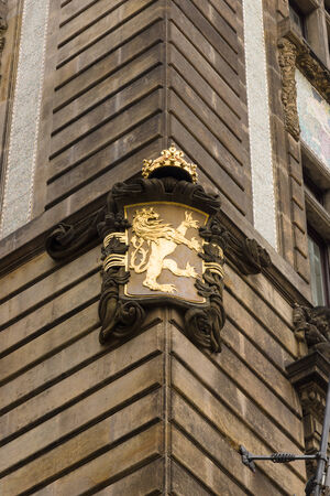 Ancient coat of arms depicting a lion on the corner of the house. The Old Town of Prague. photo