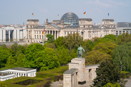 The Reichstag building aerial view. In the foreground the Tiergarten park and the Soviet War Memorial.  photo