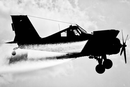 aviations: A silhouette of an airplane in the sky. Black and white Stock Photo