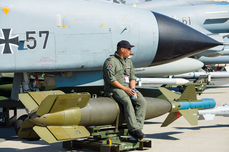 paveway: BERLIN - SEPTEMBER 14: The pilot sits on a laser-guided bomb GBU-24 Paveway III, International Aerospace Exhibition ILA Berlin Air Show, September 14, 2012 in Berlin, Germany
