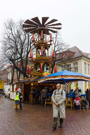 POTSDAM, GERMANY - DECEMBER 10, 2013: Traditional Christmas market in the old town of Potsdam. Christmas mill.