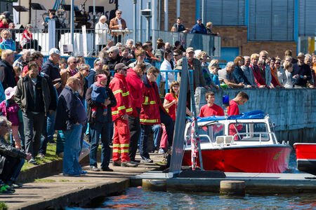rescue service: BERLIN, GERMANY - MAY 03, 2014: Motor boat rescue service and the spectators on the waterfront. 2nd Berlin water sports festival in Gruenau