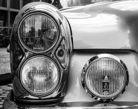 BERLIN, GERMANY - MAY 17, 2014: Headlamp of the executive car Mercedes-Benz 200 (W110). Black and white. 27th Oldtimer Day Berlin - Brandenburg Editorial