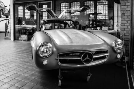 restoration: BERLIN, GERMANY - MAY 17, 2014: Body Mercedes-Benz 300SL (W198) in the restoration workshop of Mercedes-Benz. Black and white. 27th Oldtimer Day Berlin - Brandenburg  Editorial