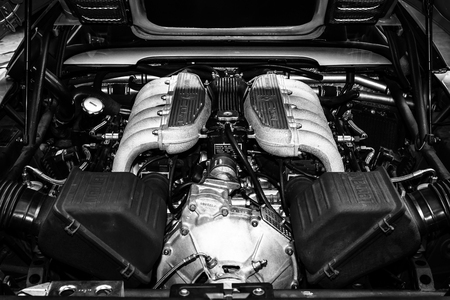 ferrari: BERLIN, GERMANY - MAY 17, 2014: Engine of a sports car Ferrari Testarossa (Type F110). Black and white. 27th Oldtimer Day Berlin - Brandenburg