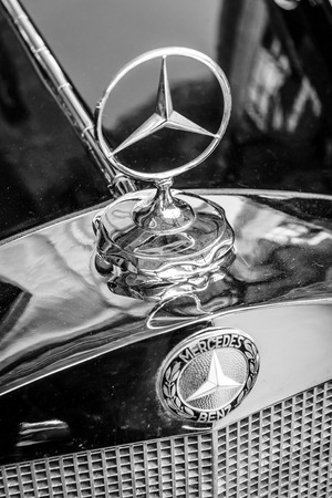 BERLIN, GERMANY - MAY 17, 2014: Hood ornament of the mid-size luxury car Mercedes-Benz W21. Close up. Black and white. 27th Oldtimer Day Berlin - Brandenburg