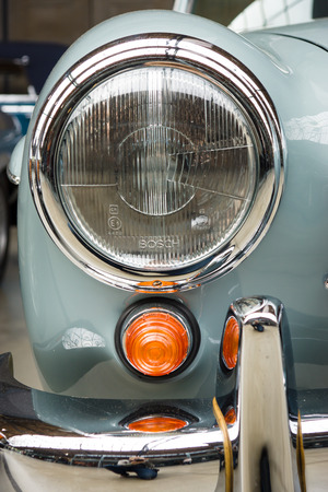 headlamp: BERLIN, GERMANY - MAY 17, 2014: Headlamp of the Mercedes-Benz 190SL, close up. 27th Oldtimer Day Berlin - Brandenburg