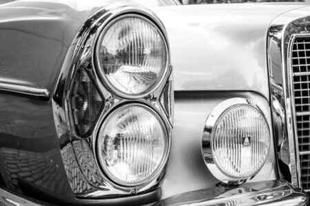 headlamp: BERLIN, GERMANY - MAY 17, 2014: Headlamp of the executive car Mercedes-Benz 200 (W110). Black and white. 27th Oldtimer Day Berlin - Brandenburg Editorial